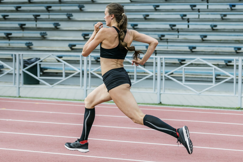 strong female runner with compression gear