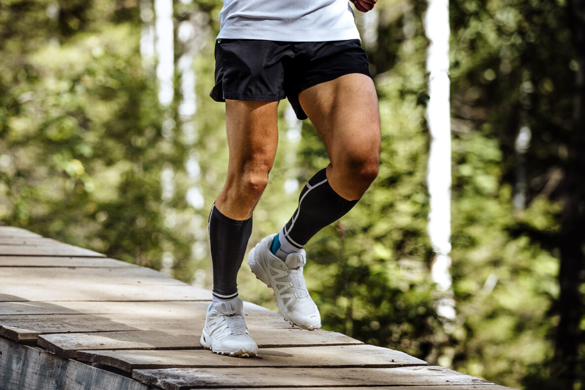 man runner in compression socks